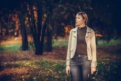 Woman walking through the park Royalty Free Stock Image