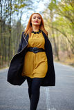 Woman walking in the park Royalty Free Stock Photo