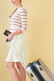 Woman Walking With Passport And Suitcase Against Colored Backgro Stock Photography