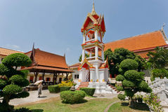 Woman walking past old bell tower of historical Wat Chalong temple Stock Image