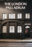 Woman walking past the stage entrance to London Palladium Theatre, London, UK royalty free stock images
