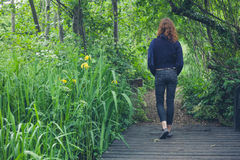 Woman walking on path in forest Royalty Free Stock Photography
