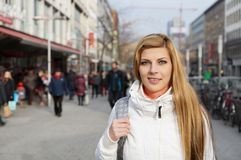 Woman walking pedestrian street Royalty Free Stock Photos