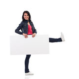 Woman walking with placard Royalty Free Stock Photo