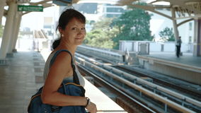 The woman walking on the platform stock video footage
