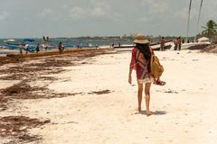 Woman walking on Playa Tulum beach. stock image