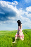 Woman walking on the prairie Stock Image
