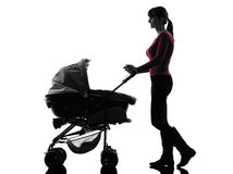 Woman walking prams baby silhouette Stock Images