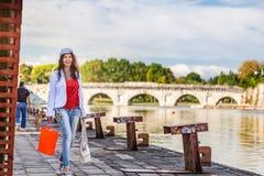 Woman walking on quay Royalty Free Stock Photos