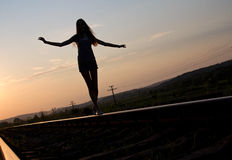 Woman walking on rail track Royalty Free Stock Photography
