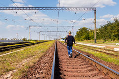 Woman walking on railroad tracks Stock Image