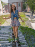 Woman walking on a rails. Royalty Free Stock Images