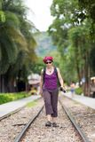 Woman walking on railway royalty free stock image