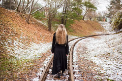 Woman walking on railway tracks Royalty Free Stock Photography