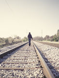Woman walking on railway tracks Stock Image