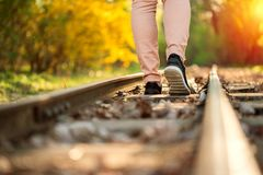 Woman walking on a railway Royalty Free Stock Images