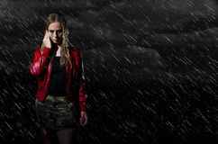 Woman walking in the rain horizontal Stock Images
