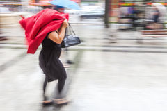 Woman walking in the rainy city Royalty Free Stock Photo