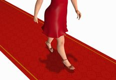 Woman walking by the red carpet Royalty Free Stock Images