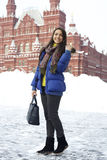 Woman walking on the Red Square in Moscow. A young woman walking on the Red Square in Moscow Stock Image