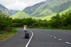 Woman walking on the road and exploring the beautiful valley of hawaii Royalty Free Stock Photos