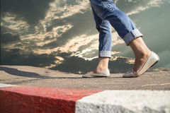 Woman walking on the road Stock Photo