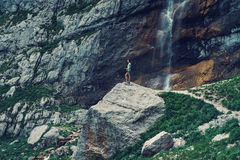 Woman walking in rocky mountains Stock Images