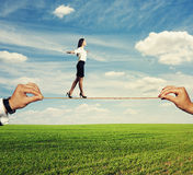 Woman walking on the rope at outdoor Royalty Free Stock Images