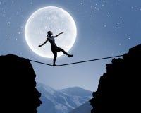 Woman walking on rope Stock Image