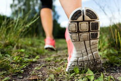 Woman walking or running, legs and shoes Stock Photography