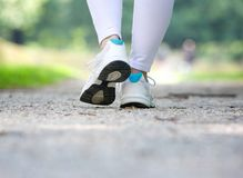 Woman walking in running shoes outdoors Stock Image