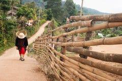 Woman walking rural village Stock Photo