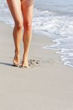 Woman walking by sand beach Royalty Free Stock Photos