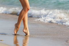 Woman walking by sand beach Stock Photography