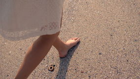Woman walking on the sand stock footage