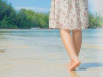 Woman walking on sand beach. Closeup detail of female feet . Beach travel - woman walking on sand beach. Closeup detail of female feet .Step up concept Royalty Free Stock Photos