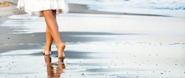 Woman walking on sand beach Royalty Free Stock Photos