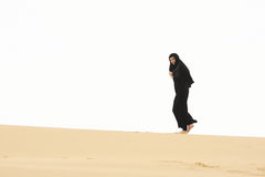 Woman walking by sand hill crest Stock Photo