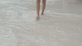 Woman walking on sandy beach on beautiful day. Slow motion.  stock video