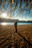 Woman walking on sandy beach at cold autumn day Stock Photography