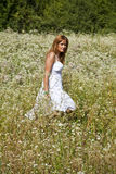 Woman Walking In Savage Garden Royalty Free Stock Photography
