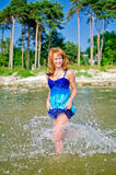 Woman walking in the sea Royalty Free Stock Photo