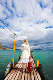 Woman walking on sea footbridge Stock Photo