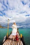 Woman walking on sea footbridge Stock Photo