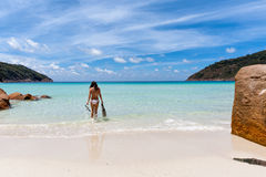 Woman walking into the sea for a snorkeling trip Royalty Free Stock Photography