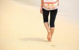 Woman walking seaside Royalty Free Stock Photography