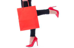 Woman walking with a shopping bag Stock Photos