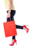 Woman walking with a shopping bag Stock Photo