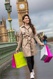 Woman Walking With Shopping Bags, Big Ben, London, England Stock Image