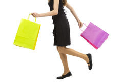 Woman walking with shopping bags in her hands Stock Photo
